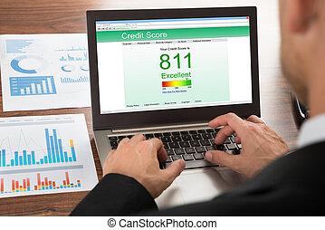 Businessman Checking Credit Score