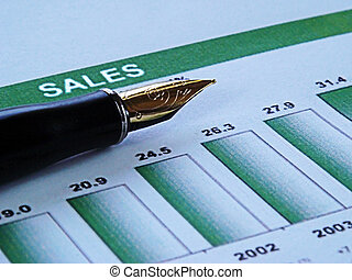 close-up of a pen on top of a financial graph showing sales growth
