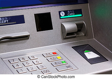 Close up of an ATM machine. Keyboard and insert card