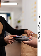 Close up of business woman doing finance and non-cash transaction