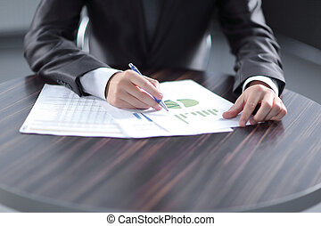 Close-up of Businessman checking financial graphs showing the results