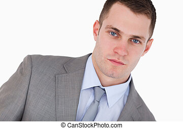 Close up of confident young businessman on white background