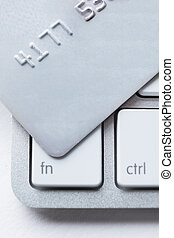 Close up of credit card on a laptop keyboard