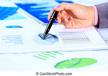Close up of female hands reviewing accounting documents