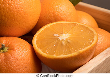 close up view of sliced sweet orange in wooden box