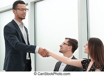 close up.handshake business partners after a successful transaction