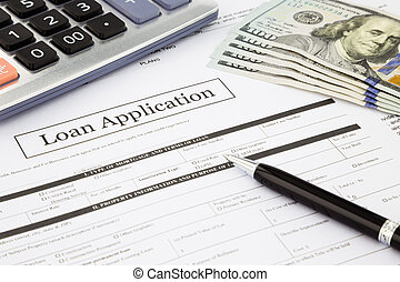 closeup loan application form and dollar banknotes, business and finance concept and idea