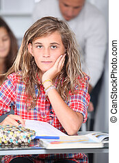 Closeup of student girl in classroom