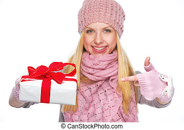 Closeup on christmas present box in hand of smiling girl
