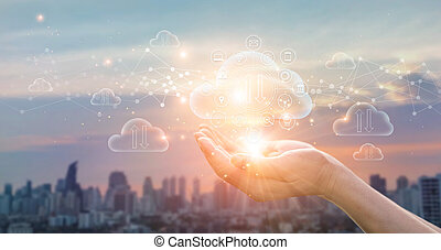 Cloud Computing Concept. Hands holding of Data protected exchange on sunset city background. networking connection. Big data and online storage. Cloud technology