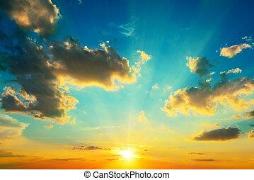 Clouds illuminated by sunlight. Sunset.