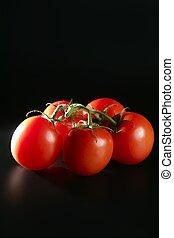 Cluster red tomato over black