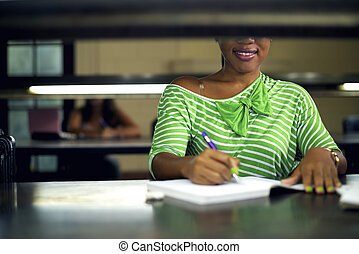 College library and female student, young black woman studying