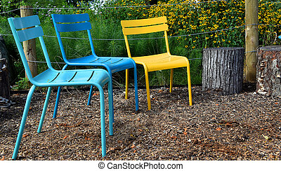 Colorful Metal Chairs in Riverfront Park