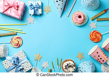 Composition with gift boxes and birthday accessories on blue background, space for text