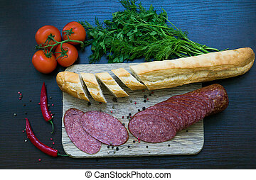 Composition with sausage on the table