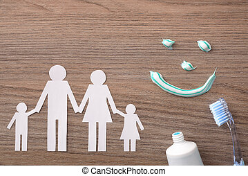 Concept of family dental insurance with representative elements on wood