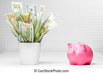 Concept photo of a pot of money and a pink piggy bank financial growth