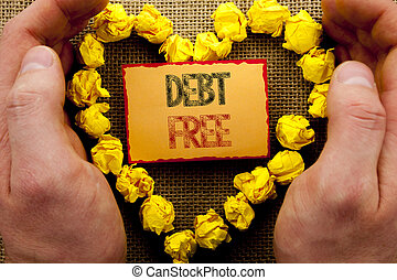 Conceptual writing showing Debt Free. Business photo showcasing Credit Money Financial Sign Freedom From Loan Mortage written on Sticky Note Paper With Heart Holding Hand with Finger