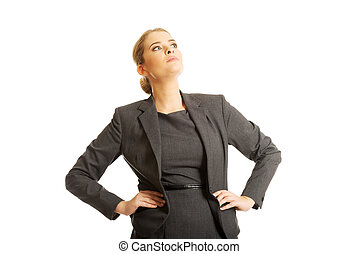 Confident businesswoman standing with her hands on hips