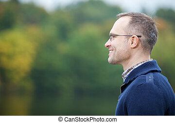 Confident Mature Man Smiling Outdoor