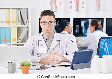 Confident young general practitioner