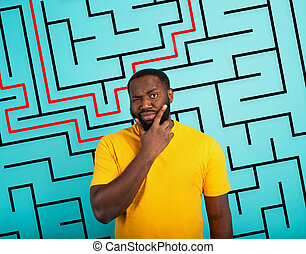 Confused Man has a big maze to solve. Concept of options, confusion, decision.