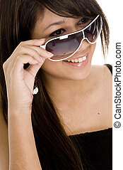 A pretty young asian teenager in funky sunglasses