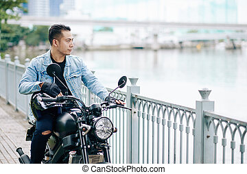 Cool Asian man with motorcycle