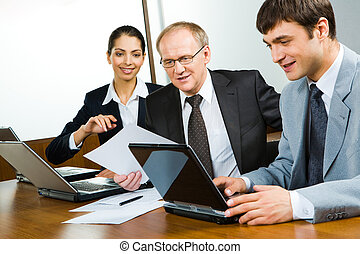 Photo of businessmen working with documents and laptop in the office