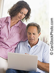 Couple in living room with laptop