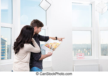couple in searching the real estate for a purchase