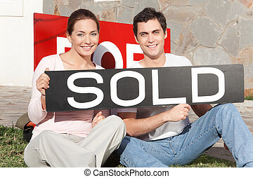 Couple Purchase New Home
