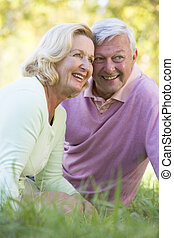 Couple relaxing in park smiling