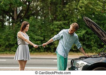 Couple repair auto on road, car breakdown