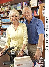 Couple running bookshop