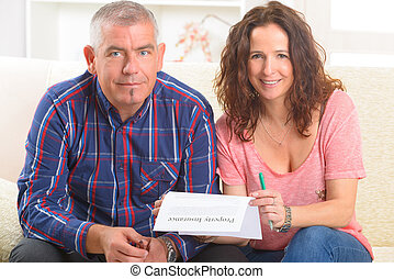 Couple signing property insurance contract