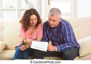 Couple signing vehicle insurance contract