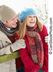 Couple Standing Outside In Snowy Landscape