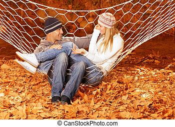 Couple talking in hammock