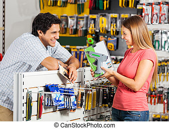 Couple With Cordless Drill In Store