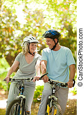 Couple with their bikes in the wood
