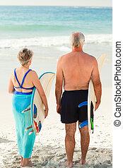 Couple with their surfboard on the beach