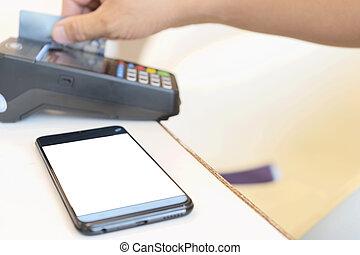 Hand Swiping Credit Card.