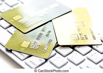 Credit cards on the keyboard close up