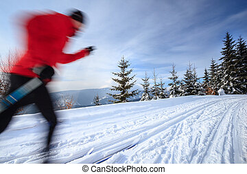 Cross-country skiing: young man cross-country skiing