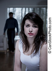 Crying woman living with aggressive husband