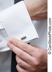 Cuff link, man is getting dressed