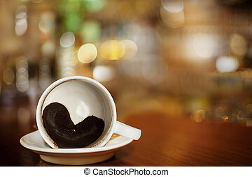 cup of coffee with Heart of Coffee Grounds on Bar, full Frame