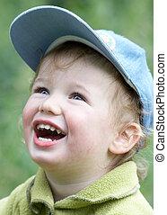 Curly kid in cap